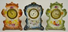 Three Antique Miniature Ansonia Royal Bonn Porcelain Clocks: 1.) Royal Bonn Actor, signed A dial, set keywind, signed floral and aqua case, not running; 2.) Royal Bonn Anchor, signed A dial, set keywind, signed floral and green case, not running; 3.) Royal Bonn Anchor, signed Germany dial, set keywind, signed floral and brown case, running