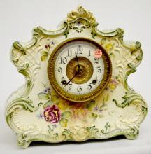 Antique Ansonia Porcelain Clock, Dresden Extra: T&S, unsigned porcelain chapter ring dial with patterned metal center, signed Ansonia movement, clock has a pendulum but no key; rose decorated cream case with light green trim and dark green outline signed Dresden Extra and Manufactured for the American Wringer Co. No. 824, 12 3/8