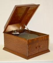 Antique Oak Table Top Model Victrola Music Player: With the speaker in the front. In good condition. Not tested. 12 1/2