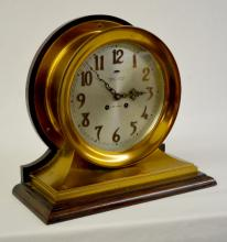 Antique Brass Chelsea Ship's Bell Clock on Oak Base: With a silvered dial marked