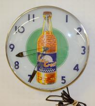 Vintage Lighted Sun Crest Advertising Wall Clock, Electric: Over a green circular center and blue numerals and convex glass. Working. 16