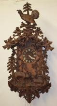 Large Ornate Carved Black Forest Cuckoo Clock:, Stag and Doe with Bird Finial, Circa 1890: With a 3 train 30 hour weight driven movement. The base is comprised of deer antlers. 60