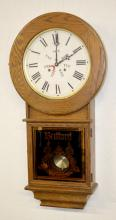 Oak Bedford Limited Edition Day of the Week Clock: T & S with a Day of the Week paper dial. The pendulum and key. The clock is tagged inside and has a paper label on the back. Not tested. 34