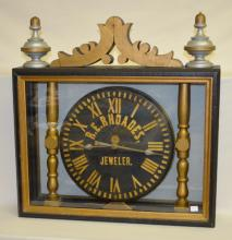 Antique Jeweler's Advertising Clock Display Sign: Mounted in a wooden case with glass front & back, large finials & crest. Set up as a clock mounted between 2 pillars; reads