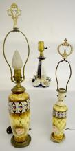 Three Porcelain Decorated Electric Table Lamps: 1)  Full size, metal foot with porcelain painted vase stem; 2) Boudoir size, matches lamp above; 3) Made in Germany porcelain base with 3 Graces medallion and gold decoration.  Tallest 26