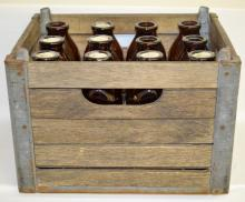 12 Borden's Milk Bottles and Milk Crate: 12 brown Borden's Signature Quality square milk bottles and a Borden's 53 Dayton O. wood crate.  Crate is 10
