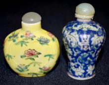 2 Chinese Porcelain Snuff Bottles: 1.) Old in blue & green enamel glaze with bats over the sign of Longevity on the shoulders and a red seal on the bottom. 2.) Newer w/heart indentation & yellow glaze; Tallest is 2 3/4