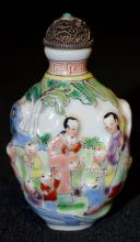 Old Chinese Famille Rose Snuff Bottle molded in relief with an all over design of many children and several women in a garden setting w/a silver filigree cap; 2 3/4