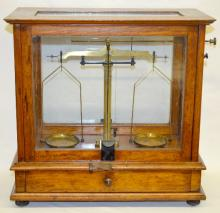 Antique Wood Cased Gold Scale with Weights, oak case with 5 glass panels, brass fixtures, complete set of weights including penny weights, double-sided doors raise and lower with set increments, 14 1/2