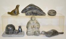 Six Eskimo Carvings by EVA.I, DIM4, T.EKAK and other, Made of Dark-Colored Soapstone