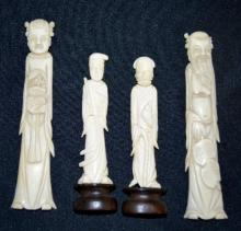 Four Chinese Ivory Figures, Two Men and Two Women: The short man has a cane and double gourd shape, female holds a fife or flute. The second pair is a man with long beard and leaf, the woman holds a vase of flowers. These two are bone, not tusk.