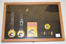 Old Dutch Cleanser Advertising Collectibles in a wooden showcase: 2 watch fobs on leather straps, celluloid back advertising mirror, pair of cufflinks, button pin, and stickpin.  Largest is 5 1/4