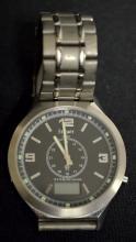 Stauer Titanium Atomic Wrist Watch #15442 on the back. The watch is not running.