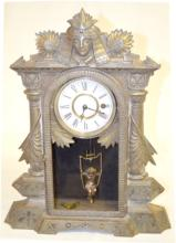 RARE!! N. Muller Sons Iron Case Egyptian Mantel Clock with a TO Movement, a paper dial, a cherub figural pendulum and the key. 19