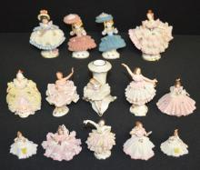 16 German & Japan Porcelain Lace Dressed Figurines: Assorted styles with lace dresses, some with applied flowers. Many are marked Germany, Dresden and Japan