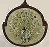 An early 20th Century mahogany polescreen, the