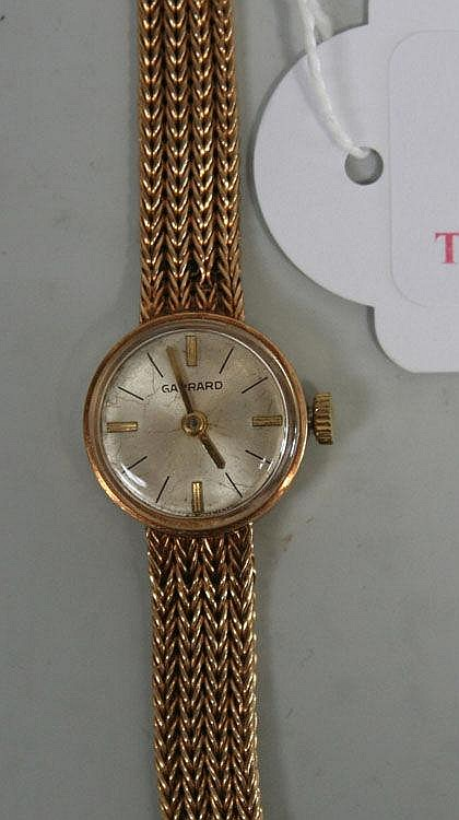 A Garrard 9ct gold lady's bracelet wristwatch, the