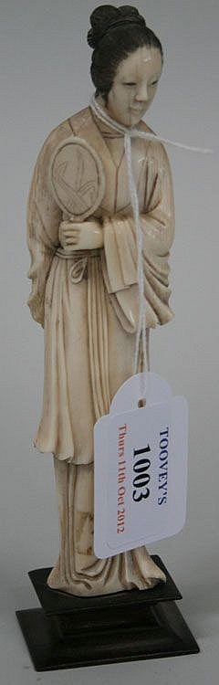 A Chinese carved ivory figure of a maiden, early