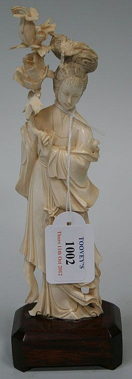 A Chinese carved ivory figure of a maiden,