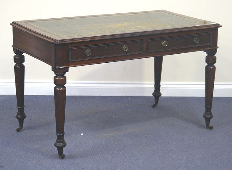 A Victorian mahogany writing table, the moulded