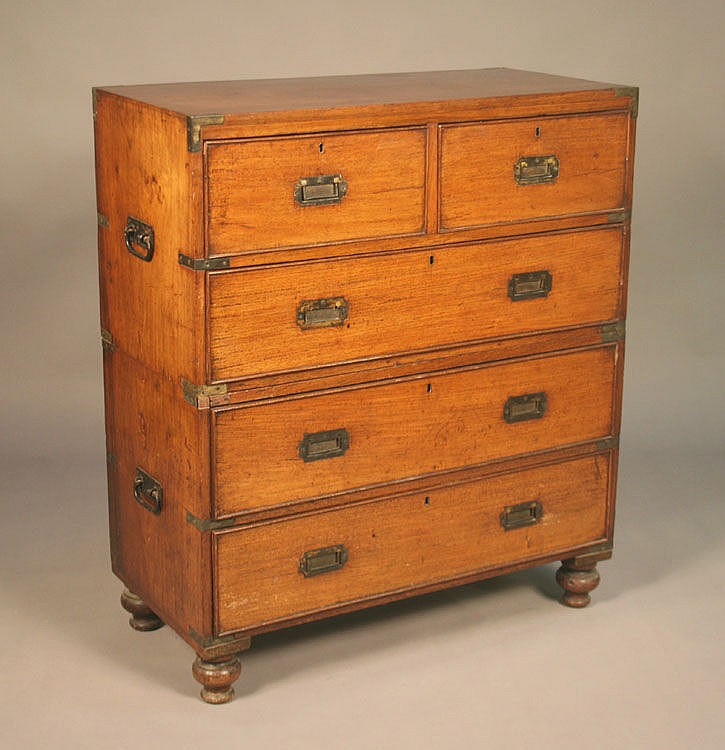 A Victorian teak campaign chest of two short and