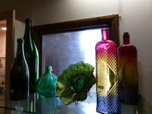 Glass Pieces : Green Glass Magnum, Deep Pontilled Green Glass Bottle, Spherical Fluted Green Glass Bottle, Two Multi Coloured Bottles and Carnival Glass Bowl
