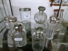 Collection of Eight Dressing Table Bottles with Sterling Silver Tops including a Cut Glass Scent Bottle