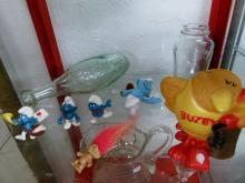 Buzby BT Money Box, Rugby Shape Glass Bottle, 'Smurfs', Brylcream Jar and 1990s Troll Keyring