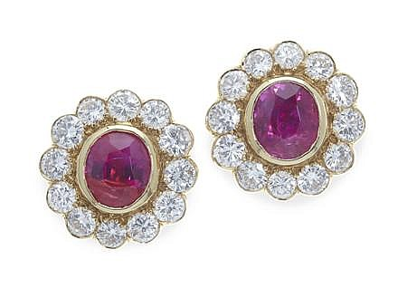 An attractive pair of Burmese ruby and diamond ear studs Estimated total weights: rubies 2.28cts; diamonds 1.44cts