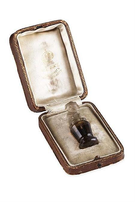 FABERGE- a carved smoky quartz seal Height 5cm