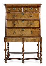 QUEEN ANNE WALNUT AND CROSSBANDED CHEST ON STAND CIRCA 1710, THE STAND LATER 108cm 1ide 166cm high, 55cm deep