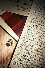 A Jacobite ring and fragment of Prince Charles Edward Stewart tartan