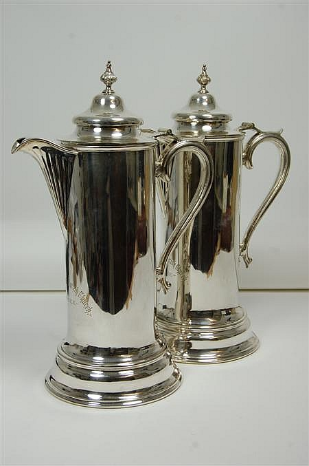 A large pair of silver plated communion flagons 42cm high