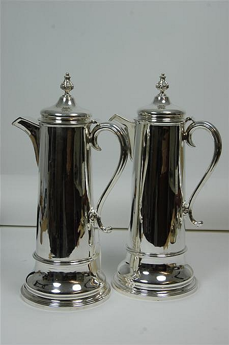 A pair of silver plated communion flagons 40cm high