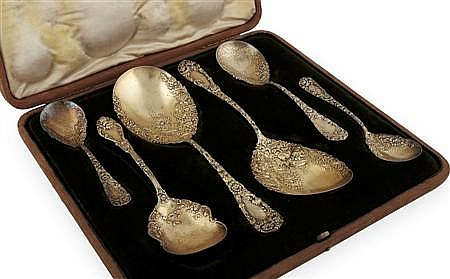 A cased set of silver gilt American berry spoons Large serving spoon 24cm long, combined weight 15.5oz