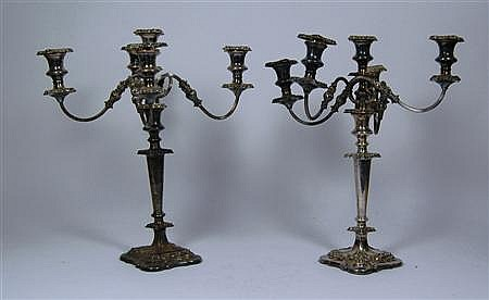 A pair of silver plated five light candelabra 45.5cm high