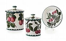 WEMYSS WARE TWO 'CHERRIES' PRESERVE JARS & COVERS, EARLY 20TH CENTURY