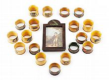 A COLLECTION OF MAUCHLINE AND TARTAN WARE NAPKIN RINGS 19TH CENTURY