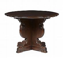 A MAHOGANY CENTRE TABLE IN THE MANNER OF SIR ROBERT LORIMER BY WHYTOCK & REID, EDINBURGH, CIRCA 1920 105cm diameter, 71.5cm high