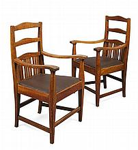 MANNER OF WALTER CAVE PAIR OF OAK ARMCHAIRS, CIRCA 1900