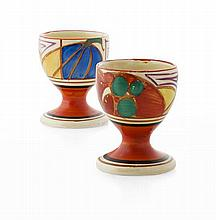 CLARICE CLIFF (1899-1972) PAIR OF 'MELON' ('PICASSO FRUIT') PATTERN EGG CUPS, CIRCA 1930 6cm high
