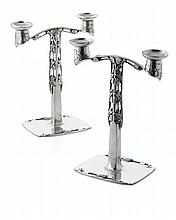 ARCHIBALD KNOX (1864-1933) FOR LIBERTY & CO., LONDON PAIR OF 'TUDRIC' PEWTER & ENAMEL CANDELABRA, CIRCA 1902 28cm high
