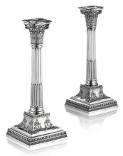 A pair of silver candlesticks Height: 27.5cm