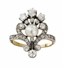 A pearl and diamond set ring Ring size: J