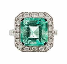 An emerald and diamond set cluster ring Ring size: N, estimated total gem weights: emerald 6.07cts, diamonds 0.58cts