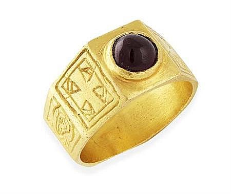 A garnet cabochon set ring, possibly Medieval circa 12th-13th century Finger size: P, 10.7g total