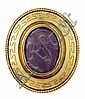 A carved amethyst set brooch 5cm x 4.5cm