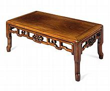 A HUANGHUALI KANG TABLE QING DYNASTY, 19TH CENTURY 75cm wide, 29cm high, 40cm deep