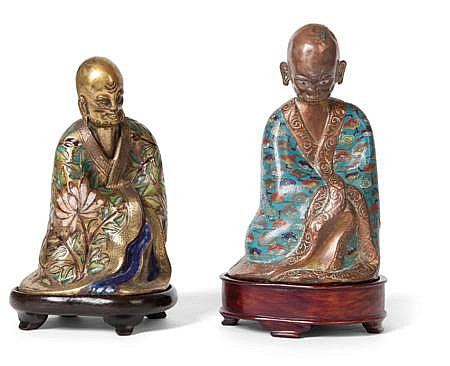 TWO CLOISONNE FIGURES OF LUOHANS QING DYNASTY, 19TH CENTURY 16cm and 17cm high (excluding stands)