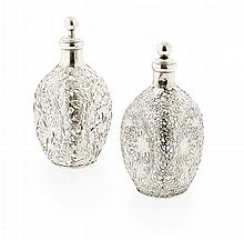 A matched pair of dimple Chinese silver mounted decanters Height: 24cm